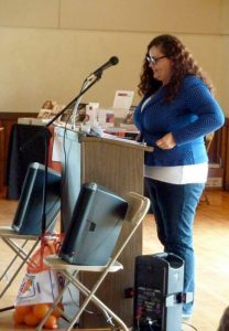 Erika Ayón reading at Orangelandia release event.